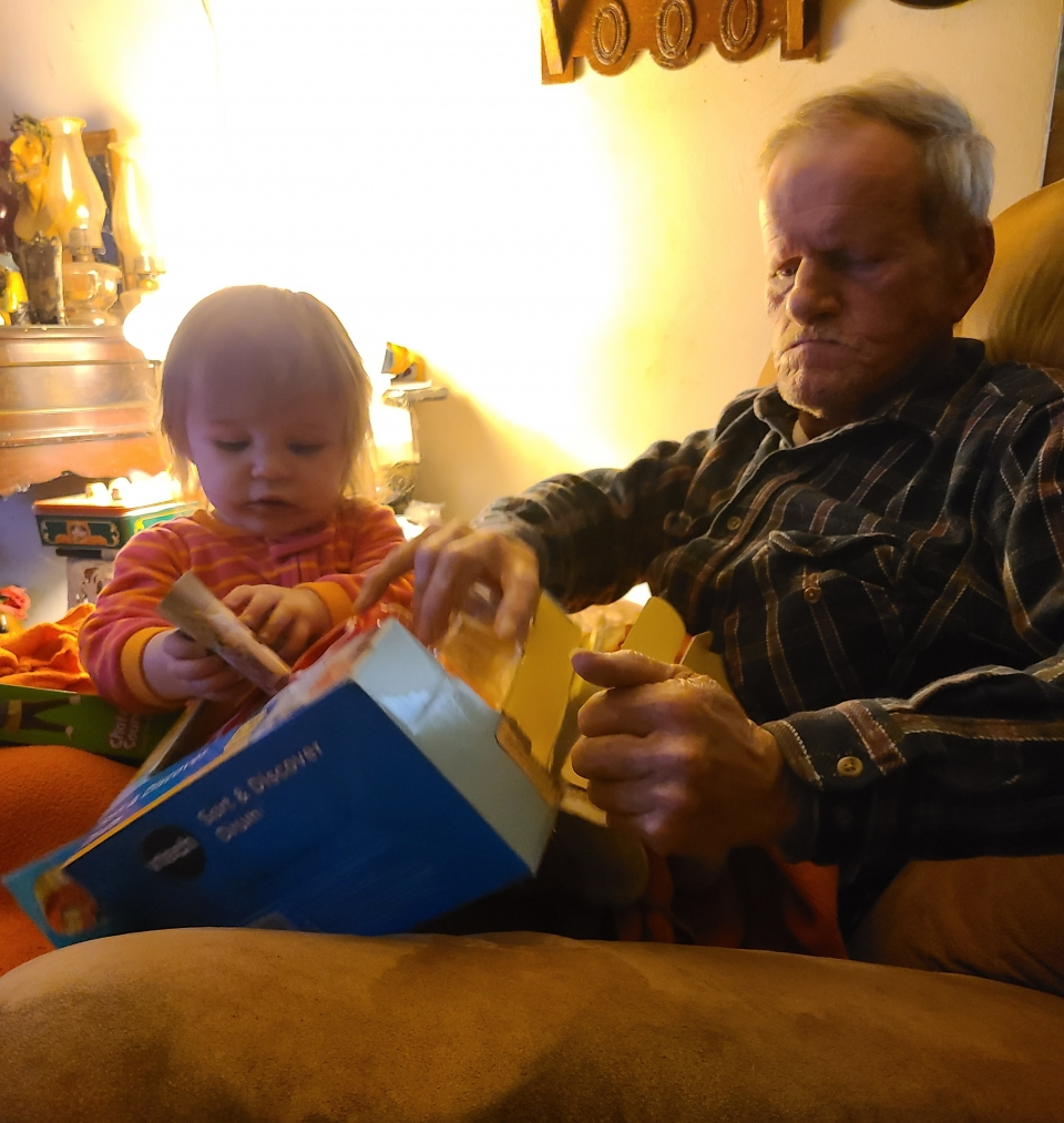 Aria and Papa opening gifts.