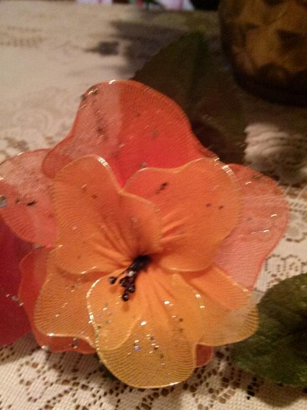 Theses Flowers have all been handmade by me, you can wear them in your hair.  If you want any feel free to contact me...